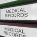 Line of multicolor office binders with Medical records tags 3D