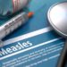 Measles - Medical Concept with Blurred Text, Stethoscope, Pills and Syringe on Blue Background. Selective Focus. 3D Render.