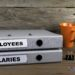 Employees and Salaries - two folders on wooden office desk