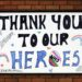 Handwritten thank you to our NHS heroes sign on brick wall