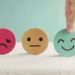 Hand choosing green happy smiley face paper cut, product, user, service feedback rating and customer reveiw, experience, satisfaction survey, psychology mental health test concept