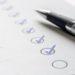 Haken an erledigte Aufgaben auf einer Liste