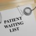 "3D illustration of ""PATIENT WAITING LIST"" title on medical documents. Medical concept."